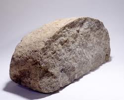 a picture of a rock that looks like a loaf of bread or a picture of a loaf of bread that's very very stale. You decide